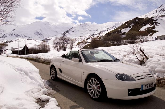 Roof down motoring in the Swiss mountains, this was taken on the Furka Pass ( just before the road was closed off ) above Andermatt