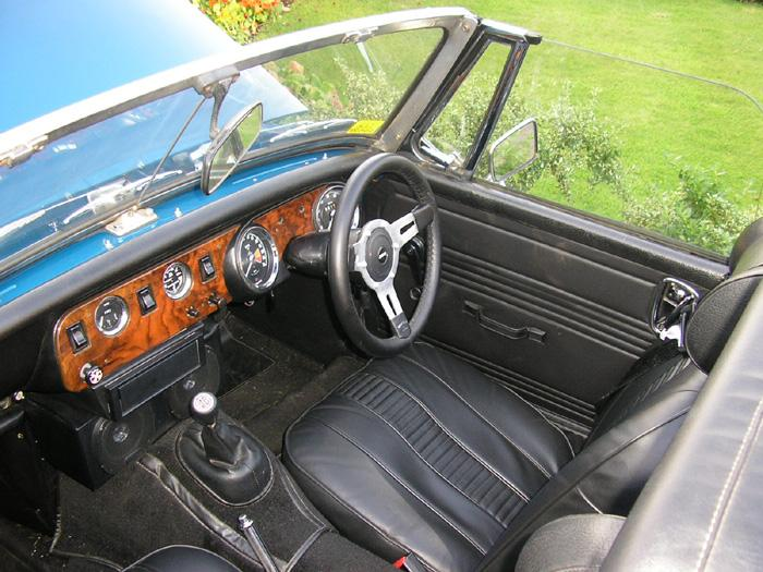 New leather gear knob and 'period' Kenwood flip-front CD player.  I'm told the seat covers must be from the Welsh MG Centre, but I wouldn't know as they were in the car when I bought it.