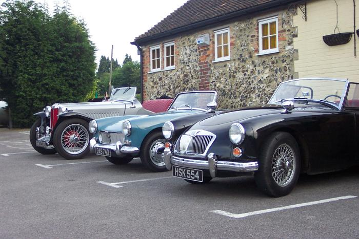 A typical cross section of cars that attend the Ashford & Faversham club nights. A 1939 TB with two 1961 cars.