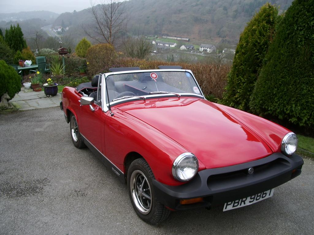 This was my Midget. Complete ground-up restoration. I regretfully sold it, but now have a 1999 MGF with only 30k on it.