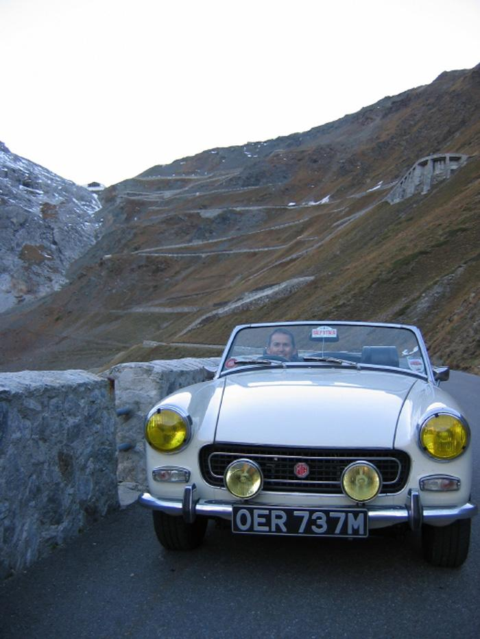 My 1974 Midget and I descending the Stelvio Pass in the Italian Alps, October 2007