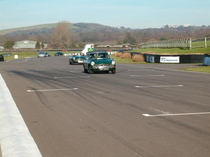 Shows MGs on the track at the Goodwood event in February 2008