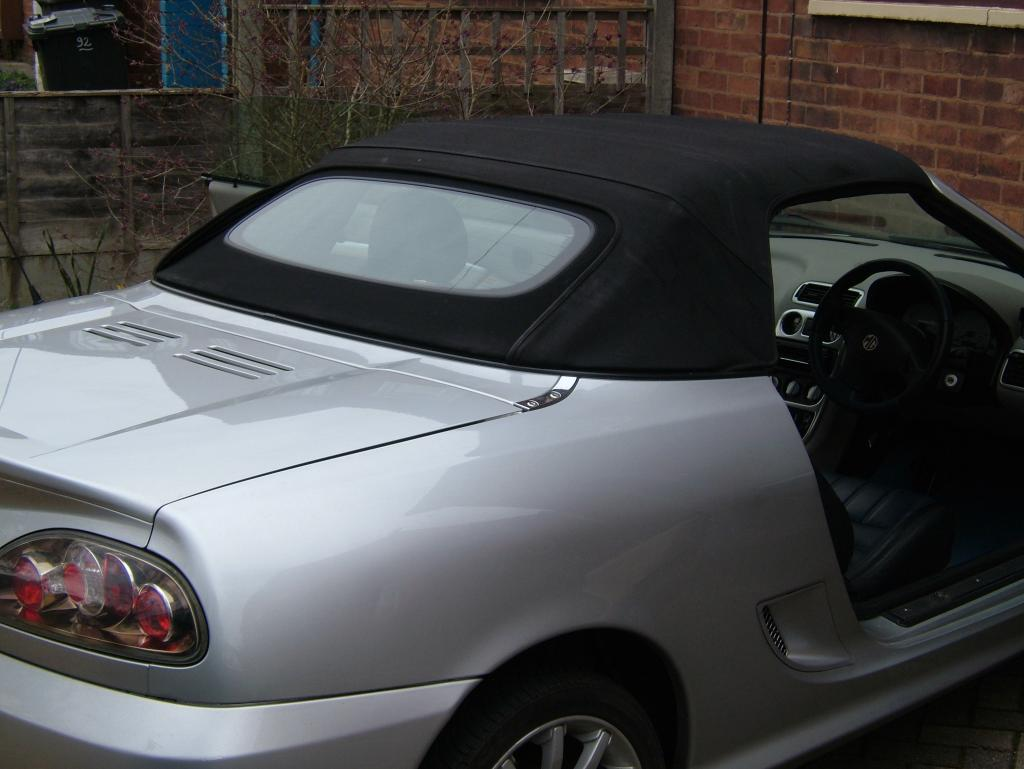 New glass rear window (Genuine MG - modified to fit)
