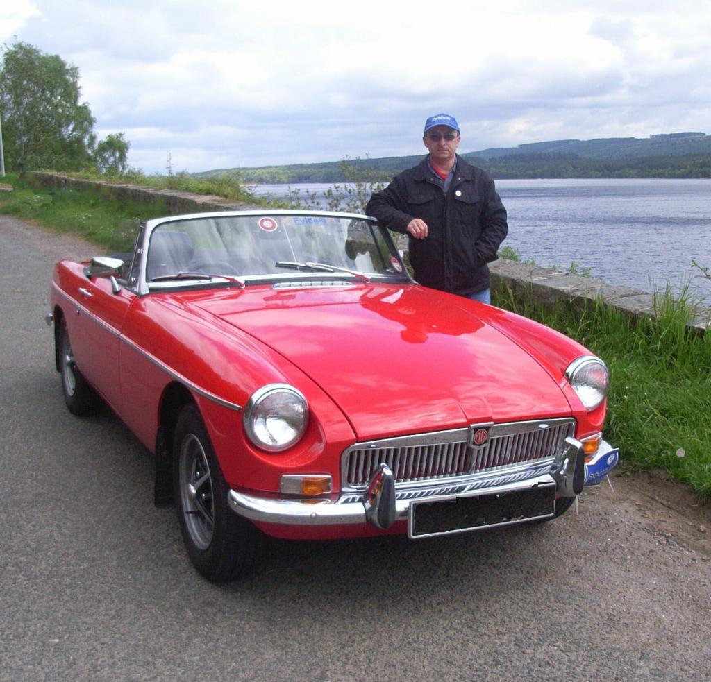 David with his 1971 MGB Roadster by the side of Loch Ness after the MG Club Scotland Trip May 2010