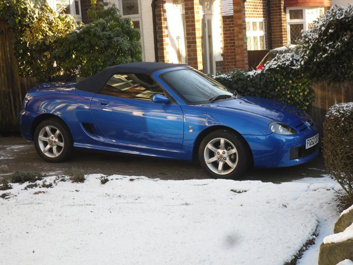 My MG TF doesnt get out much during the winter months,but heres a pic I found of her out in the snow.