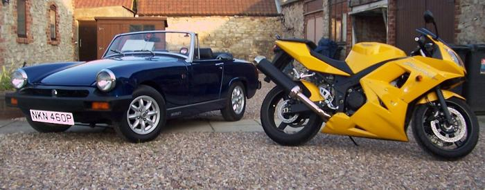 Just to prove that classic & modern and cars & bikes can work together. here is my MG Midget and Triumph Daytona